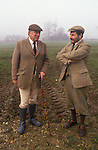Nether Worton, Oxfordshire. Major Ronnie Wallace, huntsman talking to the factor,  a member of the Schuster family staff. Nether Worton House. The Hon Mrs Lorna Schuster  birthday party she is hosting The Heythrop Hunt Meet. Wearing traditional countryside clothing.