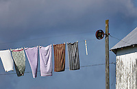 Laundry hangs to dry on an Amish farm clothesline, New Holland, Lancaster County, Pennsylvania, USA