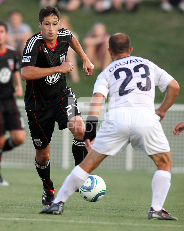 Branko Boskovic #27 of D.C. United moves towards Anthony Calvano #23 of the Harrisburg City Islanders during a US Open Cup match at the Maryland Soccerplex on July 21 2010, in Boyds, Maryland. United won 2-0.