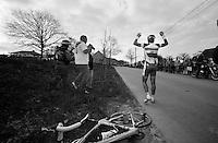 Former double Ronde-winner Stijn Devolder in despair after crashing hard in the descent of the Paterberg. Bleeding and with a broken bike he keeps yelling for the support car to show up...De Ronde van Vlaanderen 2012