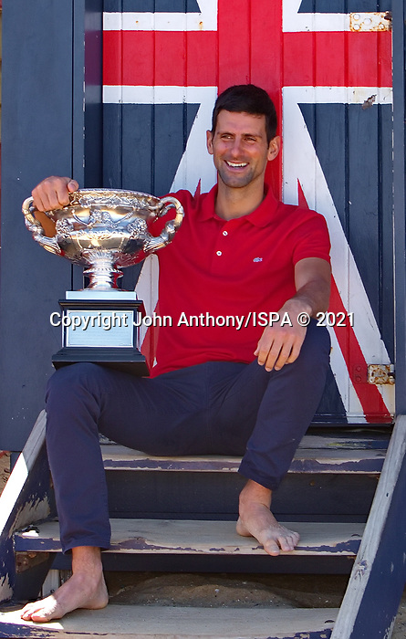 Novak Djokovic al the trophy shoot at colorful Brighton Beach after defeating Danel Medvedev in the final of the 2021Australian Open