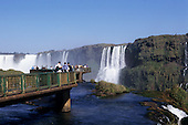 Iguassu Falls, Parana State, Brazil. Tourists looking at the waterfalls from the viewing area.