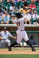 Birmingham Barons left fielder Eloy Jimenez (21) follows through on a swing during a game against the Pensacola Blue Wahoos on May 9, 2018 at Regions FIeld in Birmingham, Alabama.  Birmingham defeated Pensacola 16-3.  (Mike Janes/Four Seam Images)