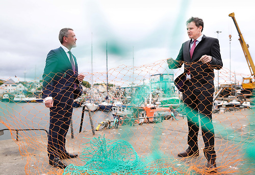 Minister for Agriculture, Food and the Marine, Charlie McConalogue T.D with Jim O'Toole, CEO BIM, at the pier in Greencastle, Co Donegal