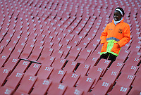A safety steward looks on from a mass of empty seats in the Ellis Park Stadium, Johannesburg. Iraq and New Zealand tied 0-0 during the FIFA Confederations Cup at Ellis Park Stadium in Johannesburg, South Africa on June 20, 2009..