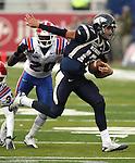 Nevada quarterback Cody Fajardo (17) runs in the first quarter of an NCAA football game Saturday, Nov. 19, 2011, in Reno, Nev. Louisiana Tech defender Jamel Johnson (20) stripped the ball on the play causing a turnover. Louisiana Tech won 24-20. (AP Photo/Cathleen Allison)