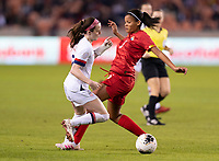 HOUSTON, TX - JANUARY 31: Rose Lavelle #16 of the United States steps through the tackle of Yerenis De Leon #5 of Panama during a game between Panama and USWNT at BBVA Stadium on January 31, 2020 in Houston, Texas.