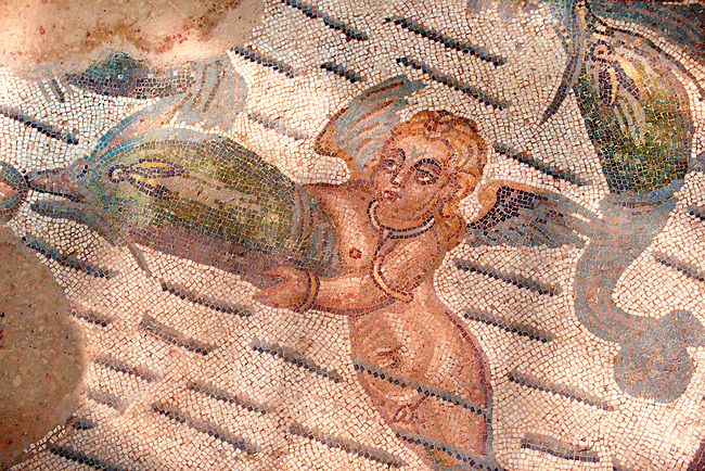 Detail of a cupid and a dolphin. Roman mosaics at the Villa Romana del Casale which containis the richest, largest and most complex collection of Roman mosaics in the world. Constructed  in the first quarter of the 4th century AD. Sicily, Italy. A UNESCO World Heritage Site.