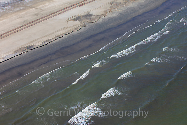 Oil stained beach on Grand Isle. Jefferson Parish, Louisiana. July 2010.