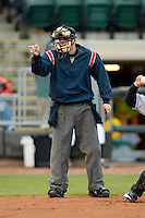 Home plate umpire Matt Benham makes a strike call in a Midwest League game between the Great Lakes Loons and the Dayton Dragons at Fifth Third Field April 21, 2009 in Dayton, Ohio. (Photo by Brian Westerholt / Four Seam Images)