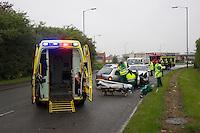 Firefighters and Paramedic crews attend RTC involving Vauxhall Nova and Ford Focus working together to release the trapped driver. Warwickshire UK. This image may only be used to portray the subject in a positive manner..©shoutpictures.com..john@shoutpictures.com