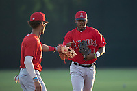 AZL Angels second baseman Jose Verrier (4) is congratulated by shortstop Jeremiah Jackson (8) while jogging off the field after completing a double play during an Arizona League game against the AZL Giants Black at the San Francisco Giants Training Complex on July 1, 2018 in Scottsdale, Arizona. The AZL Giants Black defeated the AZL Angels by a score of 4-2. (Zachary Lucy/Four Seam Images)
