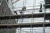 Scaffolders working on a construction site in Oxford Street, London