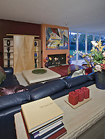 Contemporary living room with black leather sofa