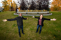 "Multicultural Fellow Amana Mbise and Assistant Professor of Psychology Sara Buckingham photoghed in front of the ""Anchorage Welcomes You"" sign on 5th Avenue. The two have partnered on a project focused on integrating immigrants into the Anchorage community."