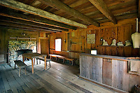 "Interior of the Vann Tavern, a Cherokee store built around 1805 by James Vann, a wealthy Cherokee plantation owner.  Moved to New Echota in 1955, it was originally built near the Chattahoochee River in what is now Forsyth County, Georgia.  The tavern served travelers on the Federal Road as a restaurant, store, and inn.  The small opening behind the counter served as a """"take out service window,"""" for those not allowed inside (slaves, children, etc.)."