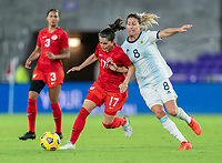 ORLANDO, FL - FEBRUARY 21: Jessie Fleming #17 of Canada fights for the ball with Clarisa Huber #8 of Argentina during a game between Canada and Argentina at Exploria Stadium on February 21, 2021 in Orlando, Florida.