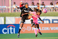Eniola Aluko (18) of Sky Blue FC heads the ball as Candace Chapman (5) of the Western New York Flash applies pressure. The Western New York Flash defeated Sky Blue FC 2-0 during a Women's Professional Soccer (WPS) match at Yurcak Field in Piscataway, NJ, on July 17, 2011.