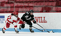 BOSTON, MA - JANUARY 11: Hayley Lunny #24 of Providence College brings the puck forward as Nara Elia #27 of Boston University defends during a game between Providence College and Boston University at Walter Brown Arena on January 11, 2020 in Boston, Massachusetts.
