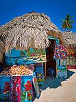 Dominikanische Republik, Isla Saona, Laguna Canto de la Playa, Holzhuetten, Verkauf einheimischer Malereien | Dominican Republic, Saona Island, Laguna Canto de la Playa, wooden huts, sale of native paintings