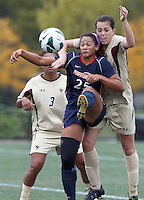 Pepperdine University forward Lynn Williams (25) attempts to control the ball as Boston College defender Zoe Lombard (20) pressures. Pepperdine University defeated Boston College,1-0, at Soldiers Field Soccer Stadium, on September 29, 2012.