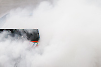19 June, 2011: Denny Hamlin disappears in a cloud of smoke as he does a burnout after winning the 43rd Annual Heluva Good! Sour Cream Dips 400 at Michigan International Speedway in Brooklyn, Michigan.