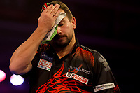 9th October 2021; Morningside Arena, Leicester, England; PDC BoyleSports Darts World Grand Prix finals ; A dejected Jonny Clayton wipes his face as nerves begin to show