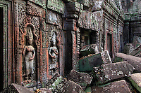 Stone carved bas relief  Apsaras (celestial maidens) at Ta Prohm, built by Jayavarman VII & part of the  Angkor Wat temple complex - Siem Reap, Cambodia...