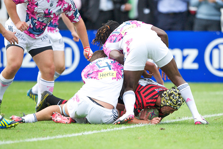 20120823 Copyright onEdition 2012©.Free for editorial use image, please credit: onEdition..Kelly Brown of Saracens scores a try between the legs of Paul Sackey of Stade Francais Paris at The Honourable Artillery Company, London in the pre-season friendly between Saracens and Stade Francais Paris...For press contacts contact: Sam Feasey at brandRapport on M: +44 (0)7717 757114 E: SFeasey@brand-rapport.com..If you require a higher resolution image or you have any other onEdition photographic enquiries, please contact onEdition on 0845 900 2 900 or email info@onEdition.com.This image is copyright the onEdition 2012©..This image has been supplied by onEdition and must be credited onEdition. The author is asserting his full Moral rights in relation to the publication of this image. Rights for onward transmission of any image or file is not granted or implied. Changing or deleting Copyright information is illegal as specified in the Copyright, Design and Patents Act 1988. If you are in any way unsure of your right to publish this image please contact onEdition on 0845 900 2 900 or email info@onEdition.com