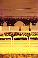 Rome, Casilina: An artistic view of some ancient arcs of the Felice aqueduct. The photo is taken on the Casilina road, by walking along the railway, in the very early morning after a snowing night. The Felice aqueduct is on the background (February, 2012).