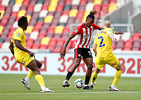 6th September 2020; Brentford Community Stadium, London, England; English Football League Cup, Carabao Cup, Football, Brentford FC versus Wycombe Wanderers; Ivan Toney of Brentford being marked by Jack Grimmer of Wycombe Wanderers and Ethan Pinnock of Brentford