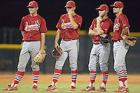 (L-R) Casey Mulligan (22), Nicholas Vera (9), Mike Folli (4) and Pete Kozma (27) watch as a relief pitcher warms up for the Johnson City Cardinals at Burlington Athletic Park in Burlington, NC, Saturday, August 25, 2007.