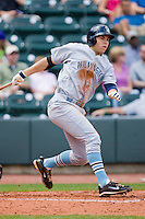 Eric Hosmer #30 of the Wilmington Blue Rocks follows through on his swing against the Winston-Salem Dash at the BB&T Park April25, 2010, in Winston-Salem, North Carolina.  Photo by Brian Westerholt / Four Seam Images