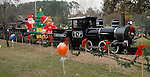 Families took train rides at the Lanier Law Firm's Holiday Bash Sunday Dec. 13,2009.(Dave Rossman/For the Chronicle)