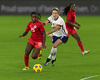 ORLANDO CITY, FL - FEBRUARY 18: Nichelle Prince #15 dribbles away from Abby Dahlkemper #7 during a game between Canada and USWNT at Exploria stadium on February 18, 2021 in Orlando City, Florida.