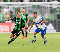 AUSTIN, TX - JUNE 19: Tomas Pochettino #7 of Austin FC and Eric Remedi #5 of the SJ Earthquakes chase after a loose ball during a game between San Jose Earthquakes and Austin FC at Q2 Stadium on June 19, 2021 in Austin, Texas.