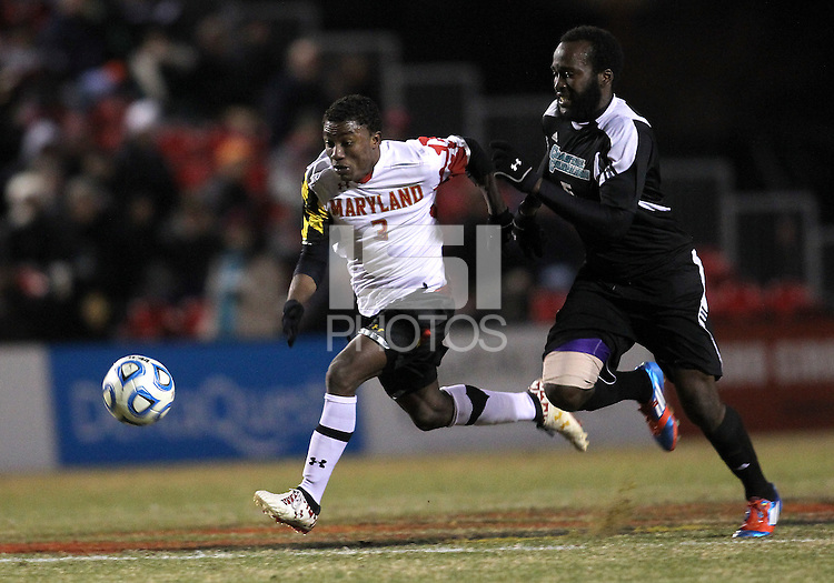 COLLEGE PARK, MD - NOVEMBER 25, 2012: Christiano Francois (3) of the University of Maryland powers his way past Jhamie Hyde (5) of Coastal Carolina University during an NCAA championship third round match at Ludwig Field, in College Park, MD, on November 25. Maryland won 5-1.