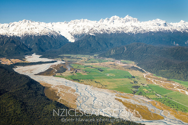 Aerial views of Waiho River with Southern Alps on horizon, Westland National Park, World Heritage Area, West Coast, New Zealand