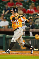 Davis Morgan #30 of the Tennessee Volunteers follows through on his swing against the Houston Cougars at Minute Maid Park on March 2, 2012 in Houston, Texas.  The Cougars defeated the Volunteers 7-4.  (Brian Westerholt/Four Seam Images)