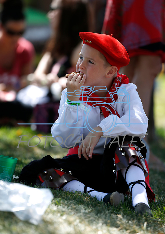 Alex Sarratea, 8, enjoys a cookie before preforming with the Mendiko Euskaldun Cluba Basque Dancers at the 4th annual Basque Fry in Gardnerville, Nev., on Saturday, Aug. 25, 2018. Hosted by the Morning in Nevada PAC, the event is a fundraiser for conservative candidates and issues and includes traditional Basque dishes like deep-fried lamb testicles.(Cathleen Allison/Las Vegas Review Journal)