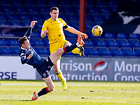 13th March 2021; Global Energy Stadium, Dingwall, Highland, Scotland; Scottish Premiership Football, Ross County versus Hibernian; Blair Spittal of Ross County challenges for the high ball with Paul Hanlon of Hibernian