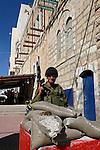 Judea, Hebron Mountain. Israeli soldier in Hebron