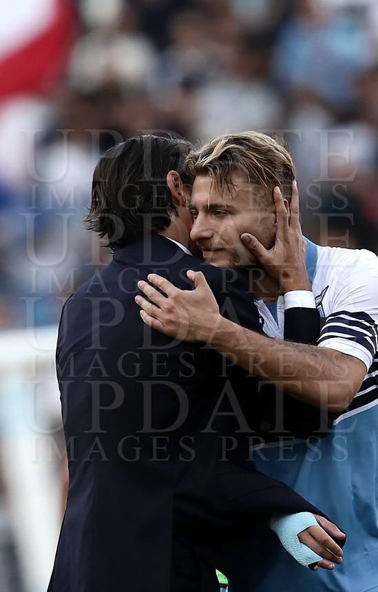 Football, Serie A: S.S. Lazio - Fiorentina, Olympic stadium, Rome, 7 ottobre 2018. <br /> Lazio's coach Simone Inzaghi (l) celebrates with his players Ciro Immobile (r) after winning 1-0 the Italian Serie A football match between S.S. Lazio and Fiorentina at Rome's Olympic stadium, Rome on October 7, 2018.<br /> UPDATE IMAGES PRESS/Isabella Bonotto