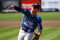 West Michigan Whitecaps first baseman Spencer Torkelson (8) throws a ball to the dugout between innings during a game against the Wisconsin Timber Rattlers on May 22, 2021 at Neuroscience Group Field at Fox Cities Stadium in Grand Chute, Wisconsin.  (Brad Krause/Four Seam Images)