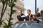 Garry Monk (left) and Alan Tate celebrate join Swansea City Football Club players and staff celebrating their promotion to the Premier League with an opentop bus tour of the city, where thousands of supporters turned out to show their appreciation..