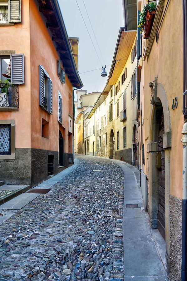 Narrow cobblestone street, Via Borgo Canale, Bergamo Città Alta, Italy