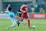 Jiangsu FC Defender Li Ang (L) trips up with Shanghai FC Forward Givanildo Vieira De Sousa (Hulk) (R) during the AFC Champions League 2017 Round of 16 match between Jiangsu FC (CHN) vs Shanghai SIPG FC (CHN) at the Nanjing Olympic Stadium on 31 May 2017 in Nanjing, China. Photo by Marcio Rodrigo Machado / Power Sport Images