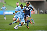 6th June 2021; AAMI Park, Melbourne, Victoria, Australia; A League Football, Melbourne Victory versus Melbourne City; Nuno Reis of Melbourne City slides in to take the ball away from Ben Folami of the Victory