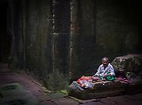 Buddhist Nun in the corridors of Preah Khan, Angkor, Siem Reap, Cambodia