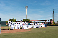 The Peoria Javelinas during the National Anthem before the Arizona Fall League Championship game between the Salt River Rafters and the Peoria Javelinas at Scottsdale Stadium on November 17, 2018 in Scottsdale, Arizona. Peoria defeated Salt River 3-2 in extra innings. (Zachary Lucy/Four Seam Images)